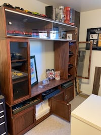 Pure Oak furniture / TV unit  Solid and in perfect condition  Hand made A lot of storage and show case area.  Glass doors on both sides of the unit and sliding glass doors at the top of the unit.  It is a 4 pieces unit.  Reason for selling: moving Deux-Montagnes, J7R 6Y5