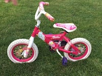 Pink and white Barbie bicycle with training wheels