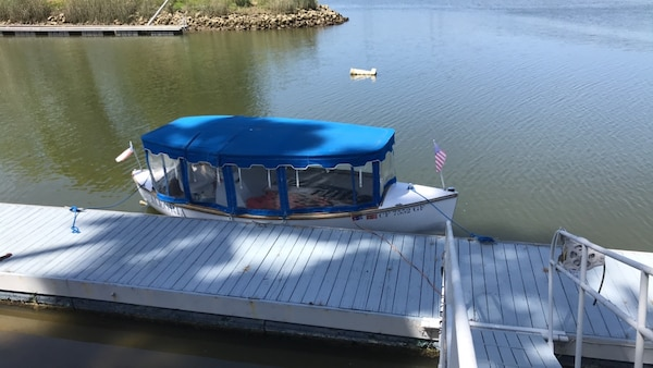 18' electric boat, overhauled motor, newer batteries  Includes trailer