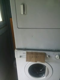 white front-load clothes washer Exeter