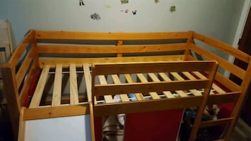 brown wooden bunk bed frame
