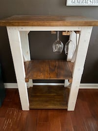 Farmhouse-style mini wine bar with wine glass rack