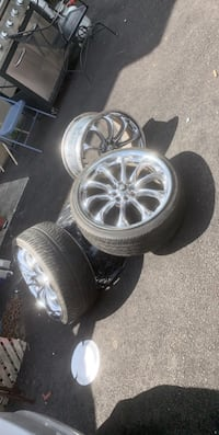 Clean Chrome Rims with 3 tires. 1 missing