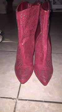 pair of red studded leather boots