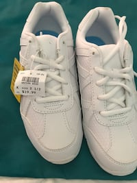 pair of white Nike running shoes Beaumont, 77703