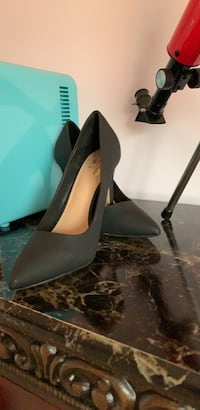 pair of black leather platform stilettos