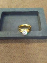gold-colored ring