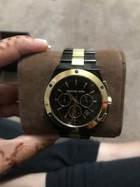 Round gold and black chronograph watch with link chain strap Richmond Hill, L4C