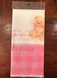 FREE, UNOPENED table cover with a baby girl theme