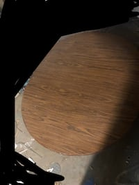 Large wooden table, 4 wooden chairs, and two leaves Des Moines, 50316