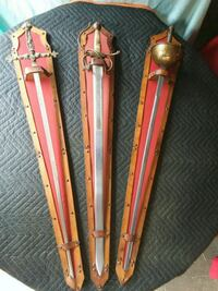 two red and brown handled swords Allentown