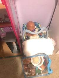 Baby doll and doll house .