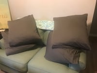 "4-25""x25"" feather pillows with grey covers"