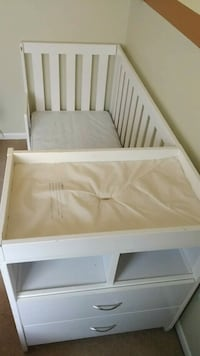 white wooden bed frame and white mattress 10 km