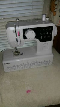 white and black Brother sewing machine 2337 mi