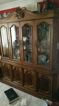 brown wooden framed glass china cabinet Laval, H7W 4S2