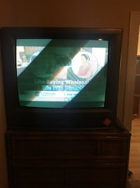 black wooden TV hutch with CRT television Eastpointe, 48021