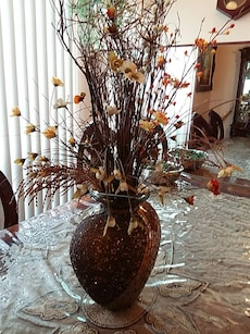 brown artificial twigs in brown vase