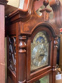 Beautiful Cherry Grandfather Clock by Howard Miller