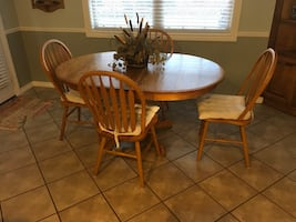Solid red oak table with 4 chairs