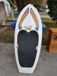 white, black, and blue Hydro Sud Pro surfboard