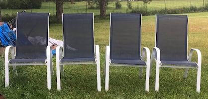 Stackable metal lawn chairs. Total of 4 metal and fabric