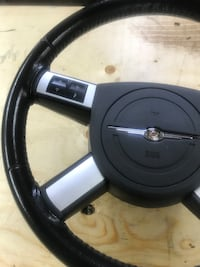 Chrysler 300 steering wheel with all the controls on it not sure if 2008 or 2010 Winnipeg, R3R 1J4