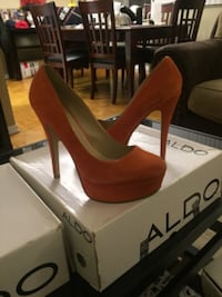 pair of red platform stiletto shoes with box null