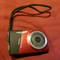 red and black Kodak point-and-shoot camera