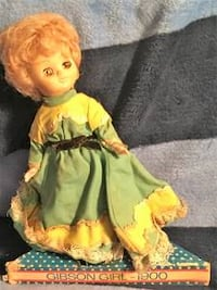 yellow and green dressed doll Placentia