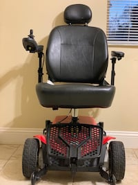 black and red mobility scooter Wheelchair  Plantation, 33324