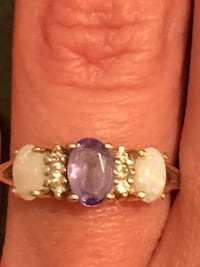 gold-colored and white pearl ring Houston, 77070