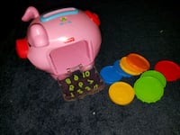 Fisher price piggy bank w/coins, plays music Howell