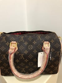 black and brown Louis Vuitton leather tote bag Brampton, L6Y