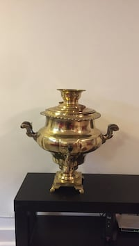 gold-colored floor vase
