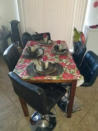 rectangular brown wooden dining table with five black leather chairs Victorville, 92392