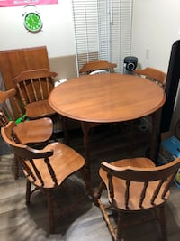 Hardwood dining set of 6chairs and a round table convertible into a long oval table Edmonton, T5T 4J2