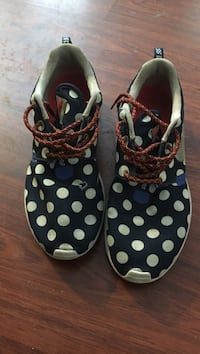 Pair of black-white-and-brown polka dotted low tops Boston, 02124