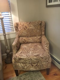brown and white floral sofa chair
