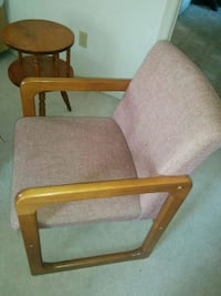 brown wooden armchair with gray cushion