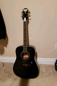 black and brown acoustic guitar Ottawa, K1T 4B6