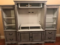 """Beautiful entertainment center. Grey chalk paint sealed with wax. Inside is painted silver cloud. Both side pieces have lights that work.   Dimensions: Center piece: 43""""L 21""""W 69""""H Both side pieces: 21""""L 17.5""""W 64""""H  $858 Franklinton, 70438"""
