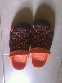 Black and orange Crocs size 2.5