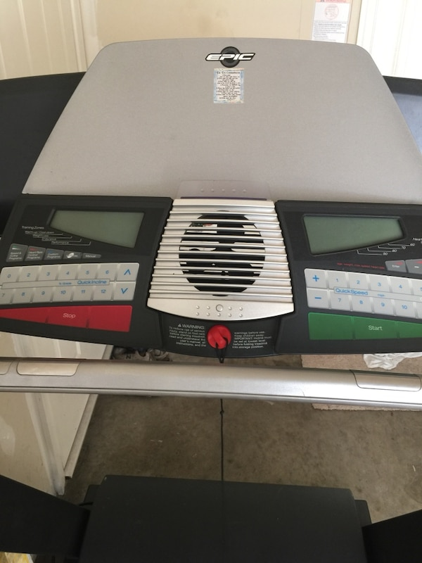White and black Epic Treadmill. 52ce2e92-6b12-438b-a264-d2278750141a