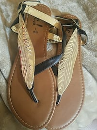 women's pair of brown leather sandals