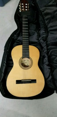 brown and black classical guitar 542 km