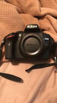 Black Nikon DSLR camera with battery and charger