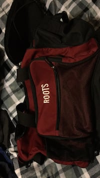 red and  white roots backpack