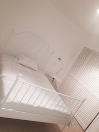 white wooden bed frame with white mattress Miami