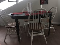 Round brown wooden table, chairs not included Arlington, 22202